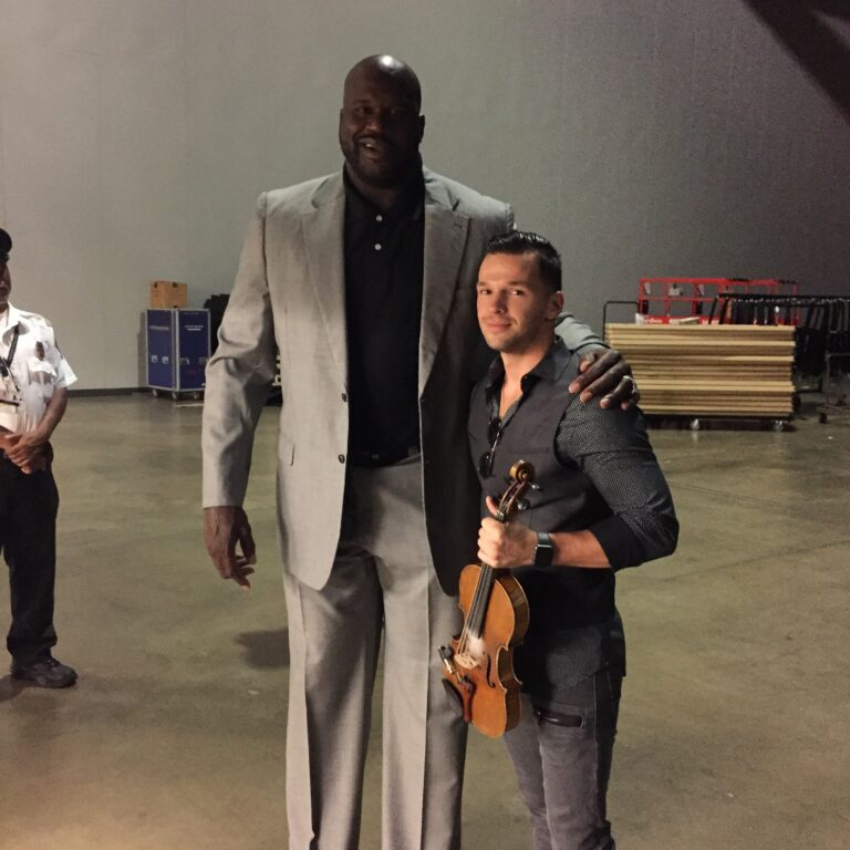 Svet the violinist performs live at the NBA half show and meets Shaquille O'Neal.